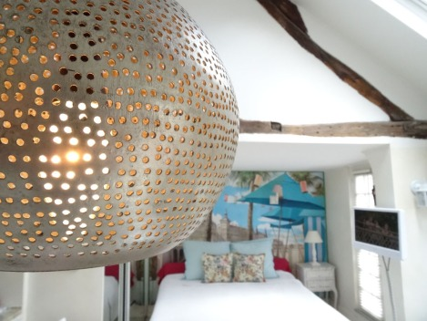 Detail of the pendant lamp from Egypt hanging over the kitchen counter. Photo: ©Lisa Anselmo