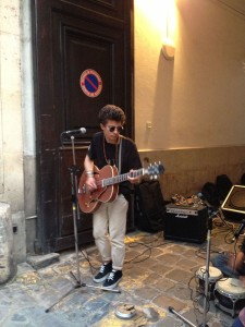 A young kid bangs out some Nirvana on Rue des Francs Bourgeois ©Lisa Anselmo