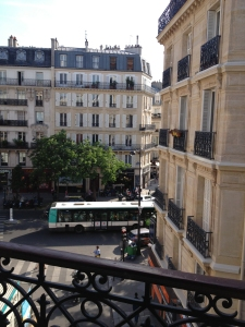 Bus rumbles by on the boulevard in this classic Parisian view. ©Lisa Anselmo