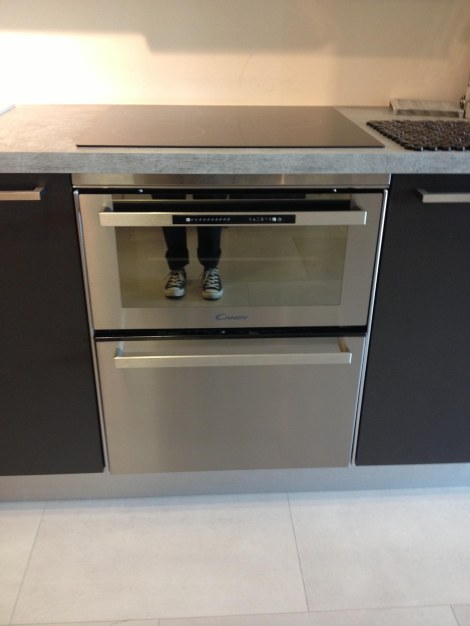 My feets reflected in a combo oven-dishwasher. The kind of space-saving ingenuity you find in Europe. About €1200. Not sure I'll splurge.