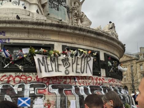 """""""Not one bit afraid"""" the banner says. Place de la Republique. ©Lisa Anselmo"""