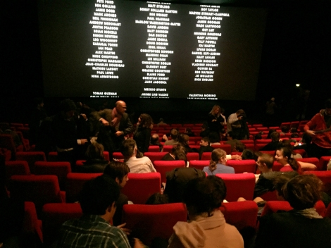 Parisians escape to the movies. Nearly a packed house at the new James Bond film.