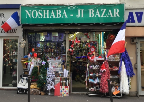 Patriotic holiday bling post-terror attacks, at the Noshaba-Ji Bazar on Rue Oberkampf. ©Lisa Anselmo