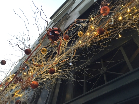 Twigs and branches are a favorite for holiday trimming. Lovely trim on Rue Charlot. ©Lisa Anselmo