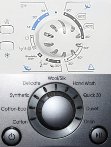 Top: The mystery that is French washing machines. Cycle selection is by temperature—in celsius no less. Why would I know that? Bottom: Blessed American laundry logic and simplicity.