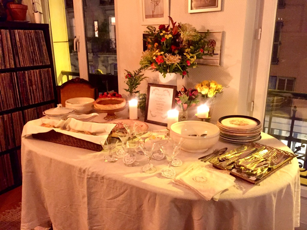 A table formally set for Thanksgiving, in a Paris apartment, captured by candlelight.