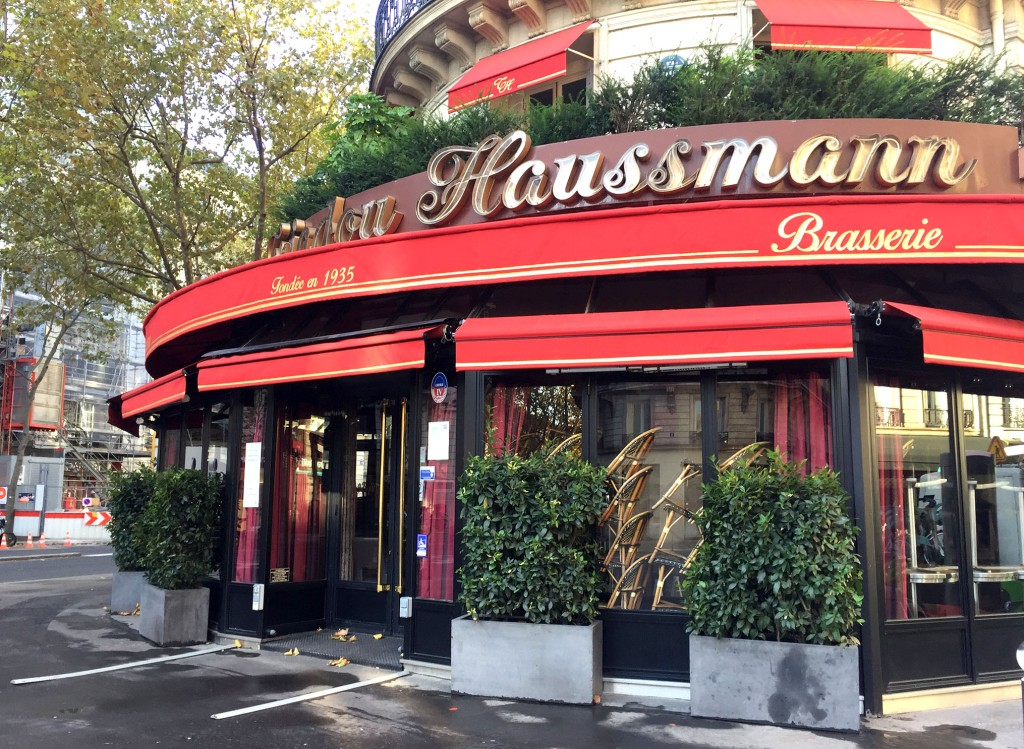 Triadou Haussmann cafe, closed during Covid, chairs stacked inside